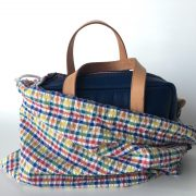 Blue Leather Mini Duffel bag in protective gingham drawstring bag