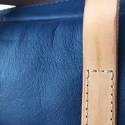 Blue kangaroo leather Mini Duffel bag with natural straps - stitch detail