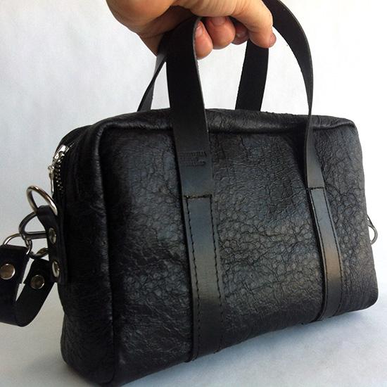 Emu leather mini duffel bag in Black