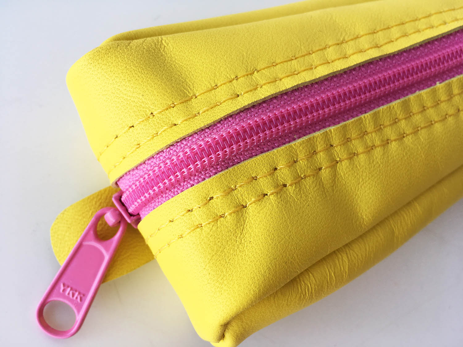 Yellow leather pencil case with pink zip