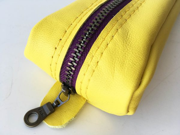 Yellow leather pencil case with purple metal zip