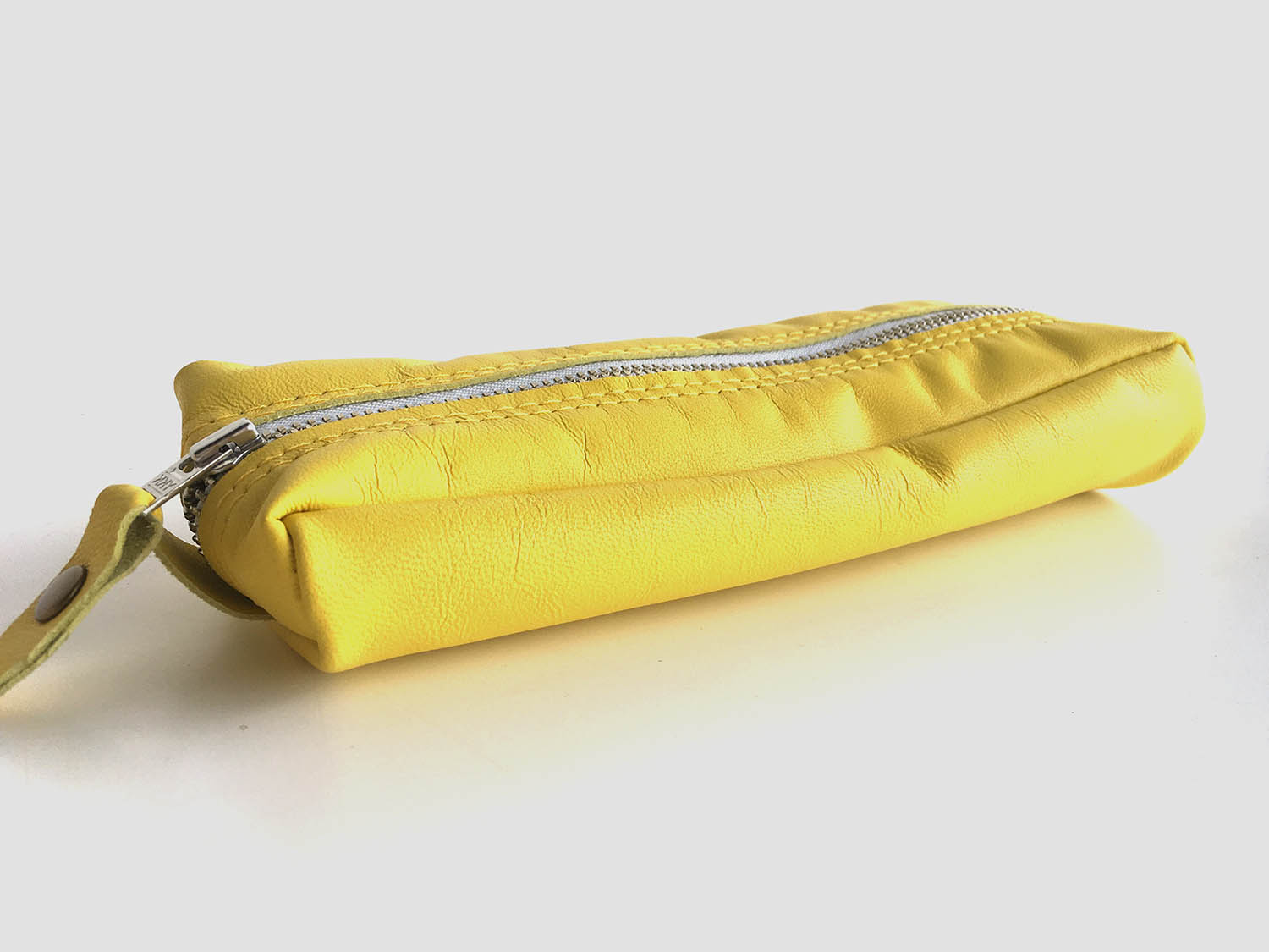 yellow leather pencil case with white metal zip